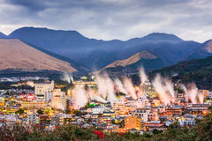 Beppu Hot Spring Resorts. Beppu, Japan cityscape with hot spring bath houses with rising steam stock images