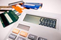Beräkning av kreditkorten arkivbild
