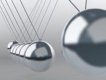 Berço de Newton de equilíbrio das esferas Fotografia de Stock