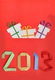 beröm för nytt år 2013 med gåvor Arkivfoton
