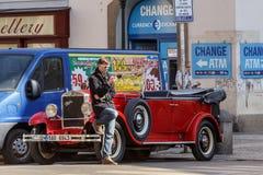 Berömd historisk röd bil Praga Royaltyfria Bilder