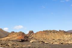 Berömda volcanoes av den Timanfaya nationalparken Arkivfoton