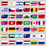 Berömt land, en uppsättning av flaggor i form av fläckar Royaltyfria Foton
