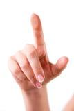 Berühren des Glases mit dem Finger Lizenzfreies Stockfoto