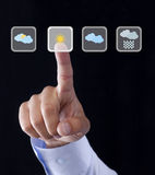 Berühren des Glases mit Wetter-Symbolen Stockfotos
