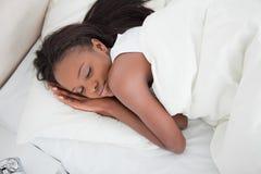 Über Ansicht eines Schlafens der jungen Frau Lizenzfreies Stockbild