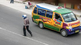 A policeman patrolling the tourist town in Sumatra. BERASTAGI, INDONESIA - September 27, 2016: a policeman patrolling busy road in one of the tourist Stock Photography