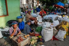 Locals sell vegetables at the local Indonesian authentic and colorful street market royalty free stock photo