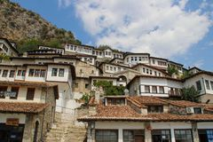 Beautifully decorated ottoman houses of historical white city under fortress and everyday life of albanian UNESCO world heritage. BERAT, ALBANIA - AUGUST 29 royalty free stock photos