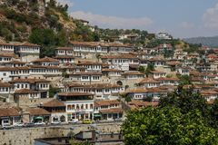 Beautifully decorated ottoman houses of historical white city under fortress and everyday life of albanian UNESCO world heritage. BERAT, ALBANIA - AUGUST 29 stock image