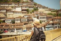 BERAT, ALBANIA - June 2018: Photographer tourist taking picture of old town Berat, Albania, Unesco World Heritage Site. stock photography