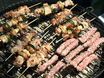 Berbecue. Mixed meat on the grill Stock Photos