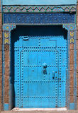 Berber blue Moroccan riad door and frame Royalty Free Stock Photo