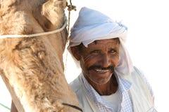 Berber. Douz, Kebili, Tunisia - September 17, 2012 : Beduins leading tourists on camels at the Sahara desert on September 17, 2012 in Douz, Kebili, Tunisia Stock Image