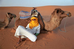 Berber guide rests Stock Image