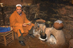 Berber man sitting by fire  Royalty Free Stock Image