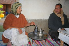 Berber man and woman at tea ceremony royalty free stock photography
