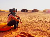 Berber Man on Zagora Desert in Morocco. Unidentified Berber man sitting in front of the tent on the Zagora Desert in Morocco, May 04, 2013. Berber people live on Royalty Free Stock Photography