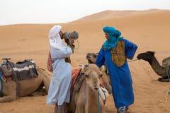 Berber men with camel Stock Photo