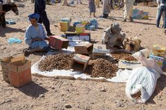 Berber men at the dates fruit market. In the South of Morocco. Dates fruit of different quality Royalty Free Stock Photos