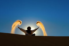 Berber playing and throwing with sands Stock Photos