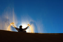 Berber playing and throwing with sands Royalty Free Stock Image