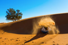 Berber playing and throwing with sands in Desert Royalty Free Stock Photography