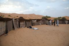 Berber tents in the desert. Morocco, Erg Chebbi: tourists at the desert camp made with Berber traditional tents. Erg Chebbi is of Morocco's two Saharan ergs Stock Photos