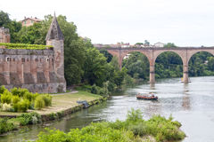 Berbie palace and a boat sailing in Tarn river in Albi Stock Photography