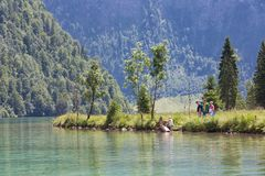 Family recreating at shore of Konigssee near Berchtesgaden Royalty Free Stock Images