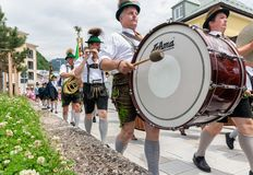 Festival with parade of fanfare and people in traditonal costumes stock photography