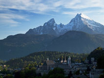 Berchtesgaden with Watzmann. Classical view from higher ground, where the church of the town is visible and behind it the Watzmann, clad in snow. The village Royalty Free Stock Photo