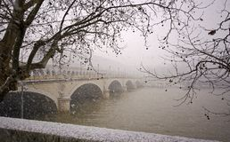 Bercy bridge under snow in paris Stock Image