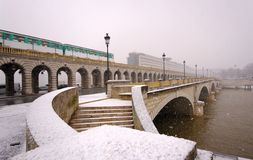 Bercy bridge under snow in paris. City Royalty Free Stock Images