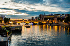 Bercy and pont de Bercy in Paris during blue hour in summer Royalty Free Stock Photo