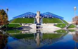 Bercy stadium in Paris. Bercy indoor arena for sports and entertainment events in Paris, France across the pond with reflection. Modern architecture inspired by Stock Photos