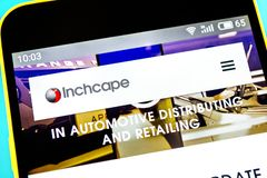 Berdyansk, Ukraine - April 18, 2019: Illustrative Editorial of Inchcape website homepage. Inchcape logo visible on the phone royalty free stock photography