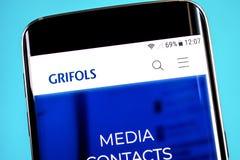 Berdyansk, Ukraine - 4 June 2019: Grifols website homepage. Grifols logo visible on the phone screen, Illustrative Editorial.  royalty free stock images