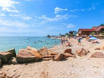 Berdyansk, Ukraine June 30, 2018: beach resort seasonon the coast of the Azov Sea. People are sunbathing on the beach. Berdyansk, Ukraine June 30, 2018: The stock images
