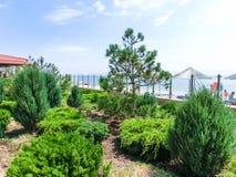 Berdyansk, Ukraine June 30, 2018: The Sun Resort Hotel at sea of Azov beach. Berdyansk, Ukraine June 30, 2018: The park at Sun Resort Hotel at sea beach royalty free stock photography