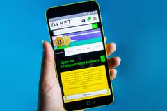 Berdyansk, Ukraine - March 23, 2019: Illustrative Editorial, Avnet website homepage. Avnet logo visible on the phone screen.  royalty free stock photos