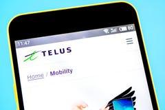 Berdyansk, Ukraine - 14 May 2019: Illustrative Editorial of TELUS website homepage. TELUS logo visible on the phone screen.  stock photography