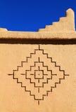 Bereber art symbols, Kasbah, Morocco. Morocco, Ouarzazate district, Kasbah - detail of an adobe built tower with Berber geometrical symbols. UNESCO World stock photos