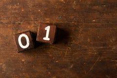 Berechnen Sie Nr. auf altem Holztisch mit Kopienraum, 01 Lizenzfreie Stockfotografie