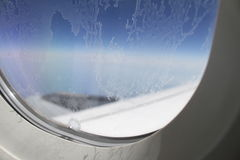 Bereiftes Flugzeugfenster Stockfotografie