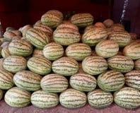 Bereiten Sie für Verkauf in einem netten Melonensatz vor stockbild