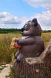 Berendeyevo, Russia, Moscow region, July 26, 2014, summer landscape with fabulous sculptures. Bear with a honey pot.