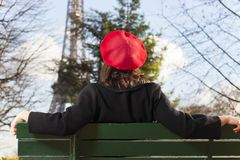 Beret. Young woman with a beret and the eiffel tower Stock Photography