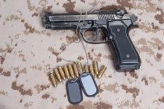 Beretta hand gun on  desert uniform Royalty Free Stock Photos