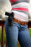 Holstered Sidearm on Lady. A Beretta Px4 Storm pistol in a holster worn by a woman on her belt. Usually intended for personal protection or by law enforcement Stock Photos